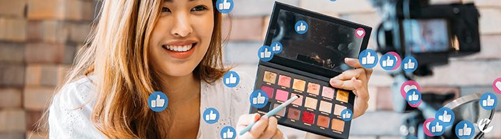 Social media live stream with influencer demoing makeup.