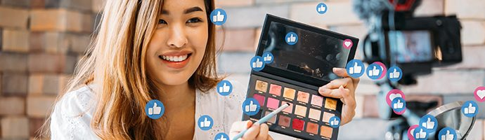 Social media live stream with influencer demoing makeup