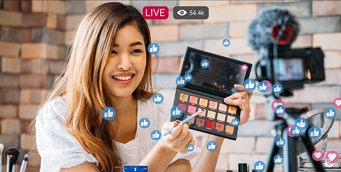 Social media live stream with influencer demoing makeup