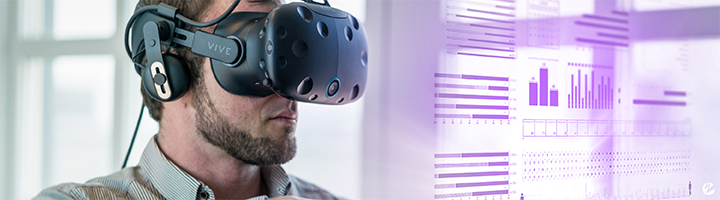 Man wearing a Vive VR headset and viewing a hollographic data visualization.