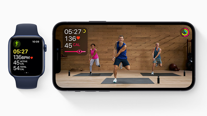 Apple watch and iPhone with live fitness class and health metrics such as calories, time, and heart rate.