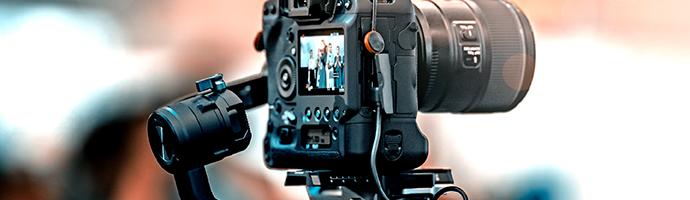 A camera on a tripod capturing a live video stream.