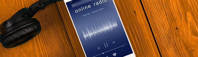 Live audio stream playing on a mobile phone with title 'online radio' and a radio station UI.