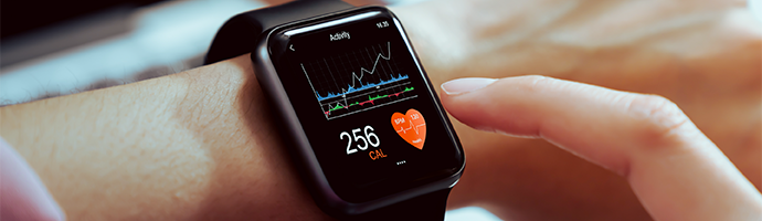 A smart wristband depicting health metrics such as heart rate, calories burned, and activity levels.