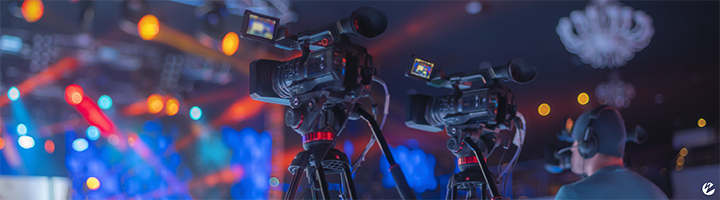 A concert or festival with a production team filming the live event for streaming to remote viewers.