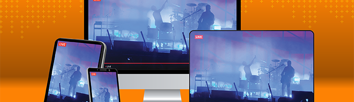 A tablet, smart phone, laptop, and desktop all displaying the same live stream of a concert.