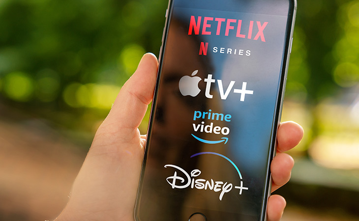 Mobile Phone With OTT Streaming Services Logos Including Netflix, Apple Plus, Prime, and Disney Plus
